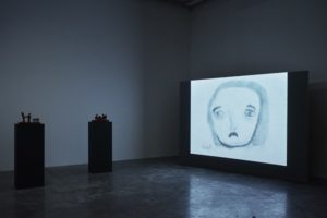 Installation view with video work by Gernot Wieland, Portrait of Karl Marx as a Young God (2009), 2017